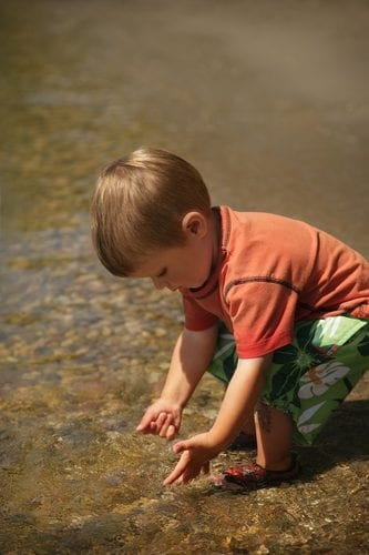 boy playing in the lake